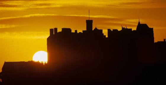 Photograph of Edinburgh Castle with a setting sun in the background
