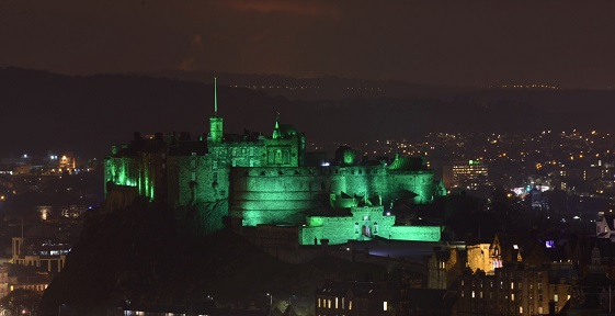 Edinburgh Castle lit up green