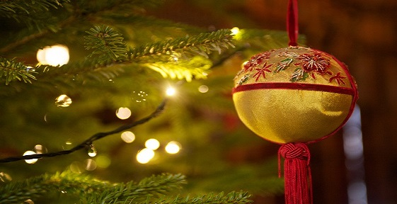 A christmas bauble on a tree