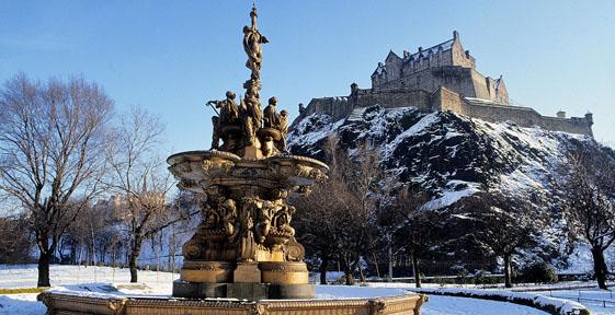 Edinburgh Castle and fountain in princess street gardens with snow