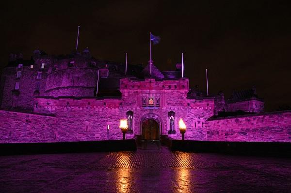 Edinburgh Castle lit up in pink