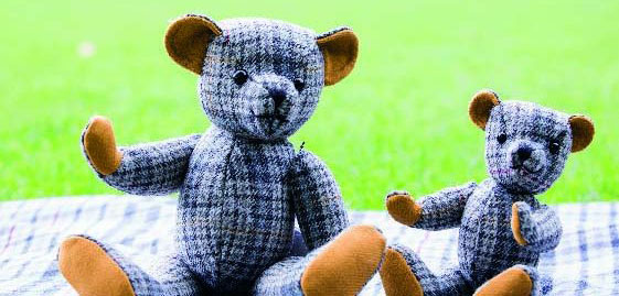 Edinburgh Castle tweed teddy bears on a tweed rug on the grass