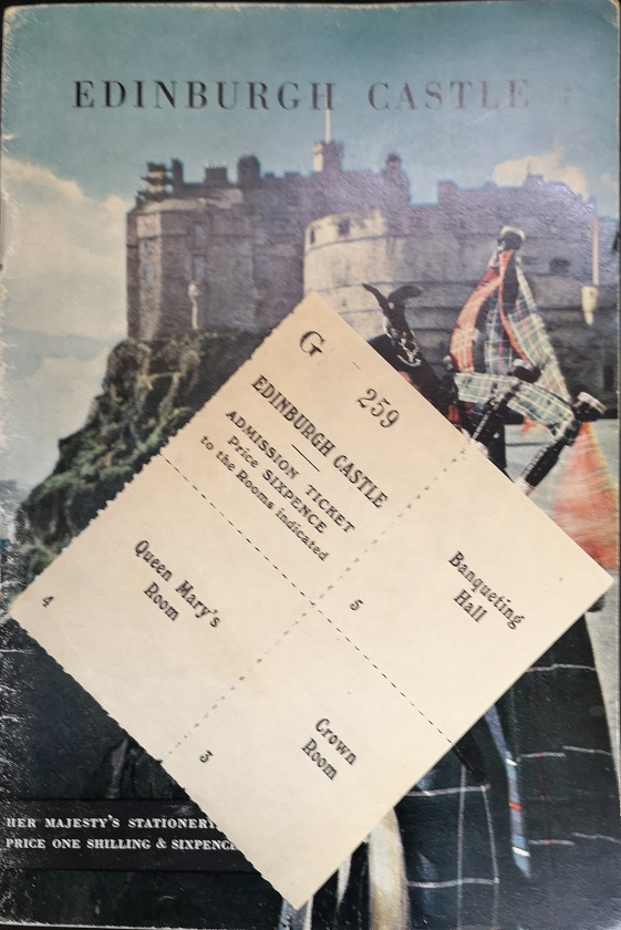 The cover of the guide book shows a drawing of a piper with the castle in the background. The ticket is perforated in quarters. The first quarter says: Edinburgh Castle. Admission Ticket. Price Sixpence to the Rooms indicated. The remaining quarters state Banqueting Hall, Queen Mary's Room and Crown Room.