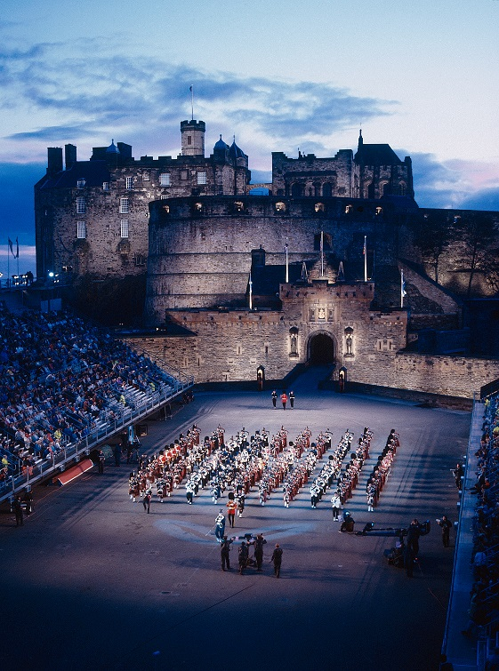 A view of Edinburgh Castle at twilight with performers in the centre of the esplanade