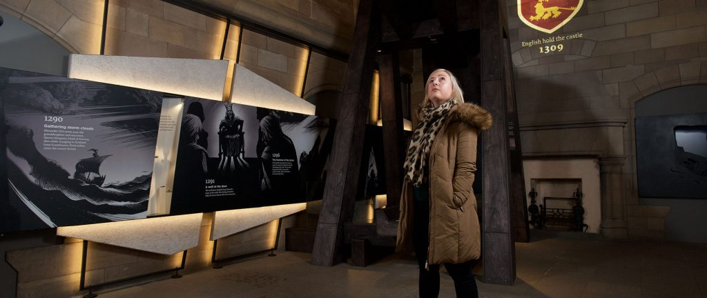 A lady gazing up at the displays at Edinburgh Castle's new exhibition