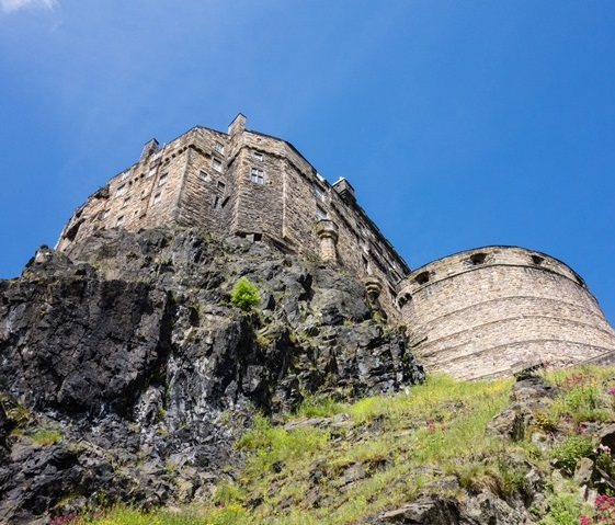 Low angle view of Edinburgh Castle taken from the bottom of Castle Rock. It looks towering and imposing.