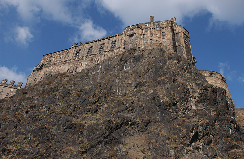 View up the sheer face of Edinburgh Castle Rock from the Grassmarket area of town.