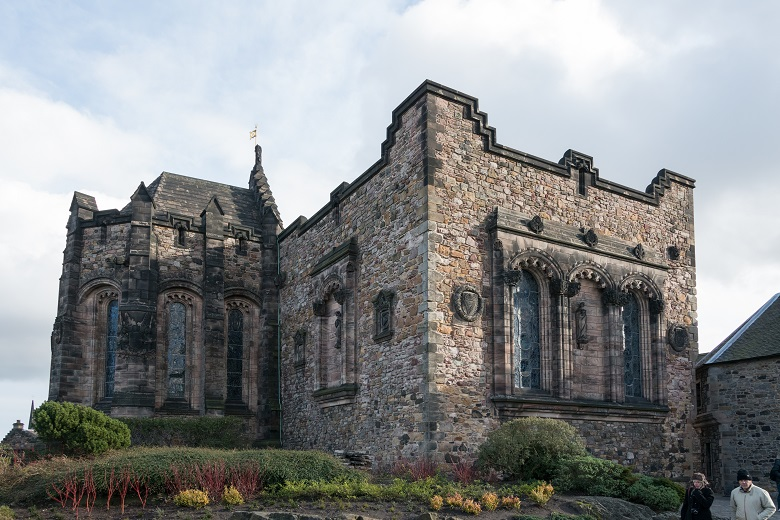 The National War Memorial at Edinburgh Castle decorated with stained glass windows and carved stone figures