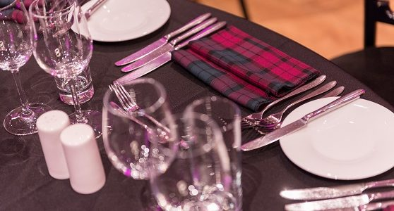 Table set of a Burns supper with tartan napkins