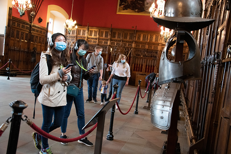 visitors inside the Great Hall at Edinburgh Castle, wearing face coverings to help prevent the spread of COVID-19.