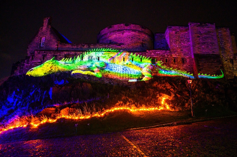 A large animation of a sleeping dragon projected onto the walls of Edinburgh Castle