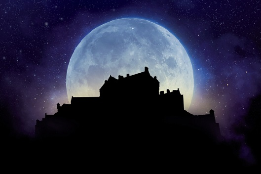 An artist's impression of a huge full moon behind the silhouette of Edinburgh Castle