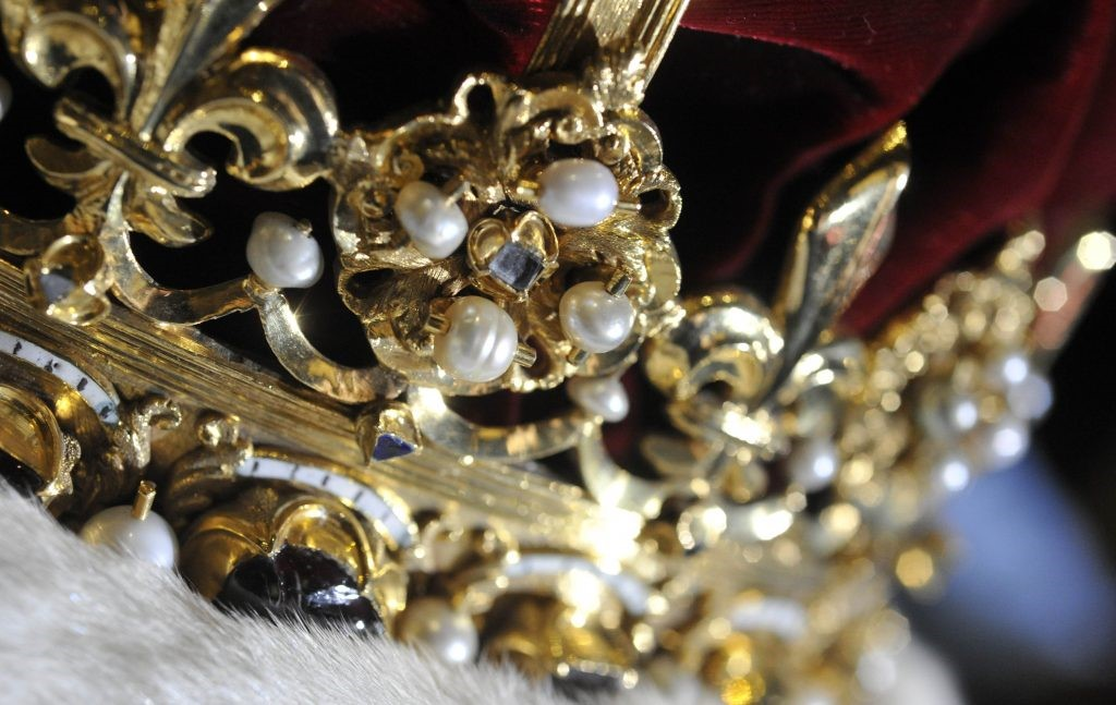 close view of crown with pearls and jewels inlaid